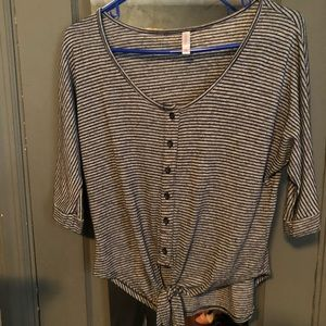 Black and white striped top with tie at bottom